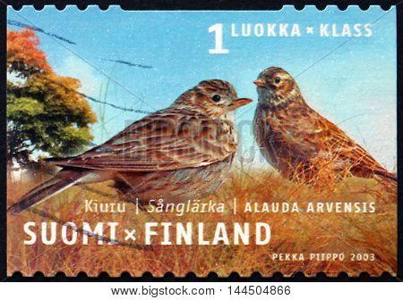 FINLAND - CIRCA 2003: a stamp printed in Finland shows Eurasian Skylark Alauda Arvensis Bird circa 2003