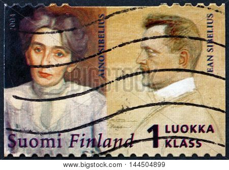 FINLAND - CIRCA 2004: a stamp printed in Finland shows Jean Sibelius and His Wife Aino circa 2004