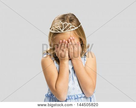 Portrait of a cute little girl wearing a princess crown