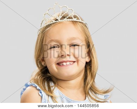 Portrait of a cute happy little girl wearing a princess crown