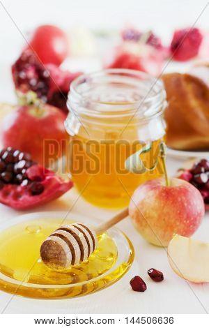 Pomegranate, apple, honey, hala for Jewish New Year Holiday Rosh Hashana. Traditional food set.