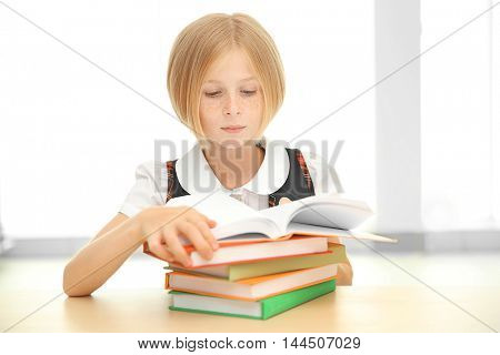 Girl with many books at school