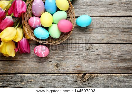 Easter Eggs With Tulips On A Grey Wooden Table