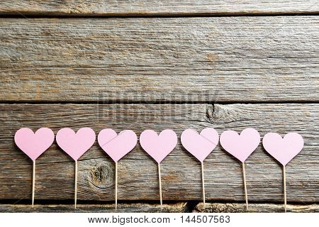 Pink Paper Hearts On Grey Wooden Table