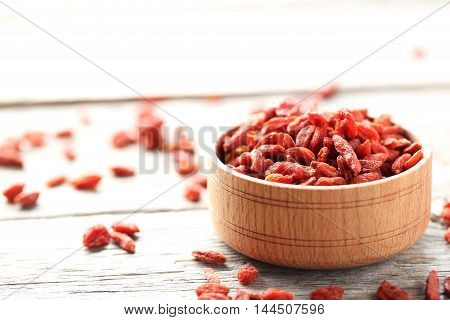 Dry Goji Berries On Grey Wooden Table