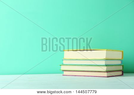 The Books on a green wooden table