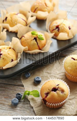 Muffins With Blueberries On Grey Wooden Table