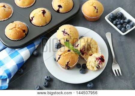 Muffins With Blueberries On A Grey Table
