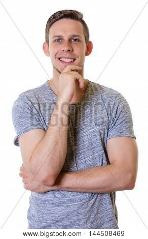 Happy blonde caucasian guy with grey shirt on an isolated white background for cut out