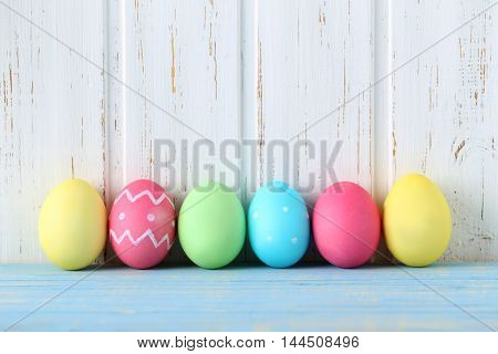 Easter Eggs On A Blue Wooden Table