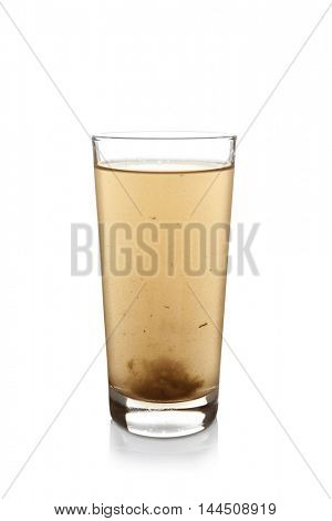 Dirty water in glass, isolated on white