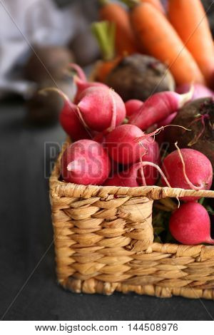 Fresh vegetables in wicker basket, closeup