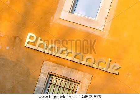 Pharmacy store in Roussillion village in Provence countryside, France