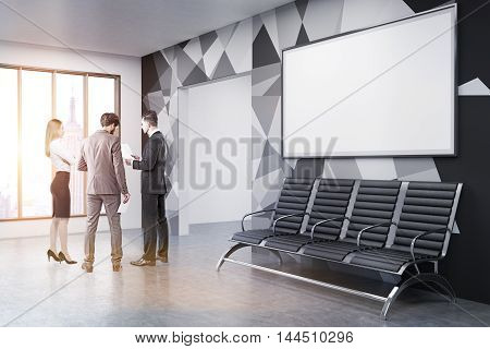 Two men and woman in suits discussing project details in office lobby with chairs panoramic window and horizontal poster on wall. Concept of brainstorming. 3d rendering. Mock up. Toned image