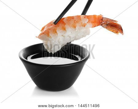 Delicious shrimp sushi with soy sauce, isolated on white