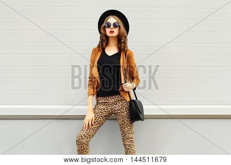 Fashion Look, Pretty Woman Wearing A Retro Elegant Hat, Sunglasses, Brown Jacket And Black Handbag O