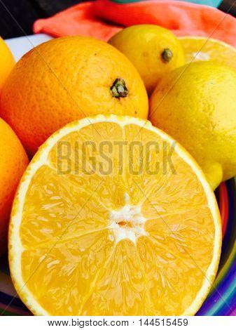 Fresh halved orange in closeup, selective focus