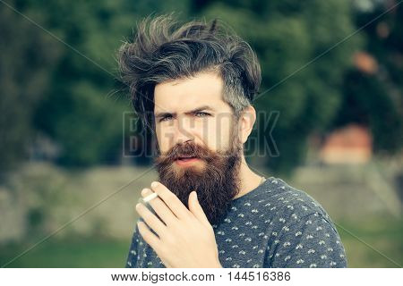 Bearded Man Smoking Cigarette Outdoor