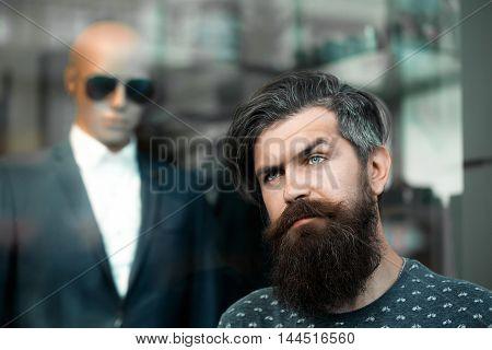 Bearded Man Near Showcase With Dummy