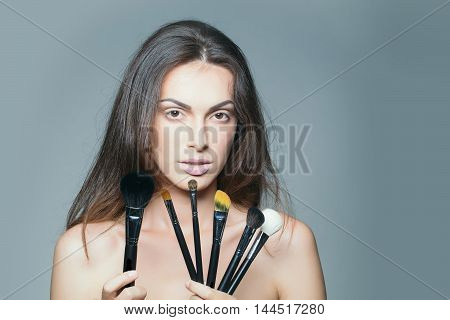 Pretty Woman With Makeup Brush