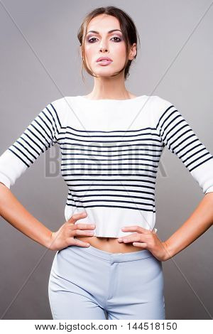 Pretty Stylish Woman Posing In Studio