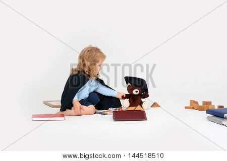 Small Boy Playing With Bear