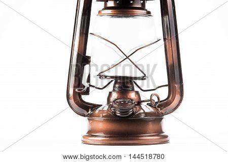 Part of old-fashioned metal kerosene lamp isolated over white background
