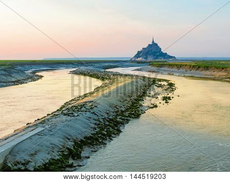 Couesnon river and Mont Saint-Michel at twilight. France