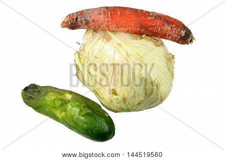 Old Rotten Vegetables on a White Background