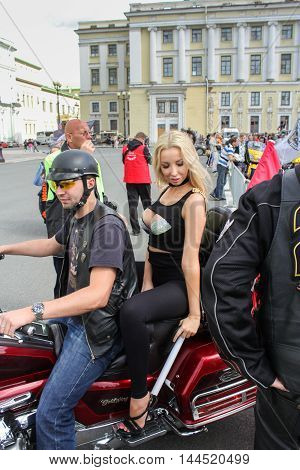 St. Petersburg, Russia - 13 August, Young model on a motorcycle,13 August, 2016. The annual parade of Harley Davidson in the squares and streets of St. Petersburg.