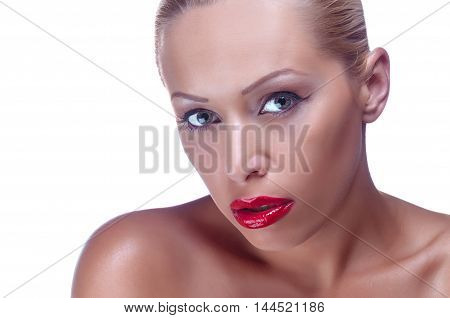 Close up of a beautiful woman holding her face