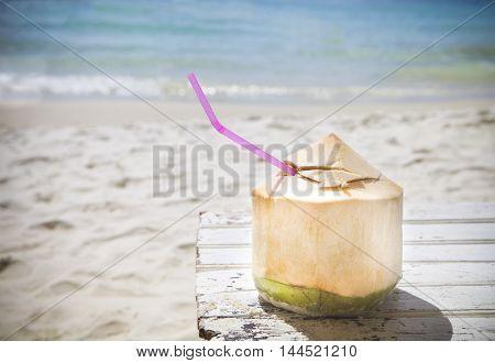 Fresh coconut cocktail on the tropical beach