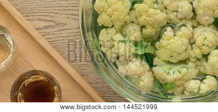 Close up cauliflower recipe beside cooking ingredient