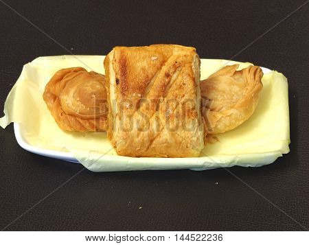Curry puff and pie on dish - fried dessert