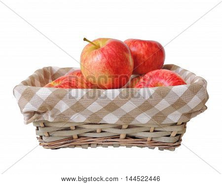 Garden fresh ripe red apples in basket isolated on white background.