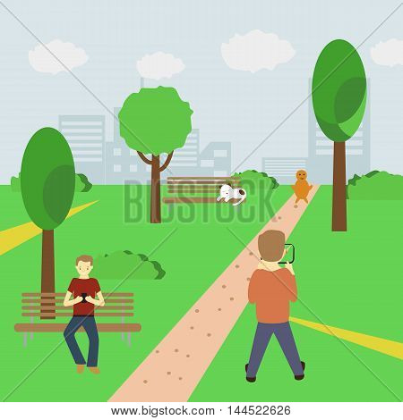 Man playing an augmented reality game using location information in park catching characters and holding smartphone in his hands