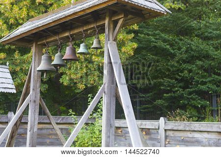Small Church Bells Hanging in a Row