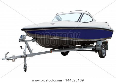 Blue motor boat loaded on the trailer for transportation.