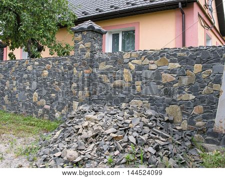 Fence of a private house  decorated with a decorative stone