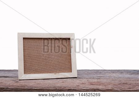 Blank wooden picture frame on wood tableinterior design and copy space