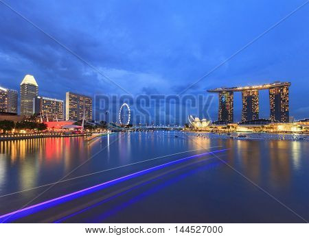 Singapore Singapore - December 12 2015 : Lighting of tourist boat and night view of Marina Bay a famous tourist attractions in Singapore.