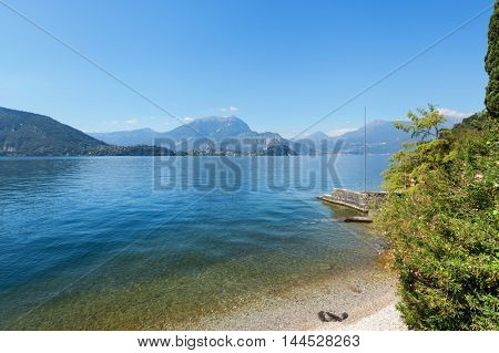 Landscape with lake and mountains, view from the shore