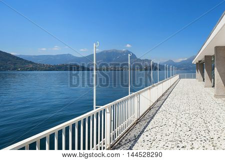 Panoramic view from the balcony of an old penthouse, lake and mountains