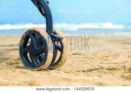 wheels stroller beach blue sea background sand