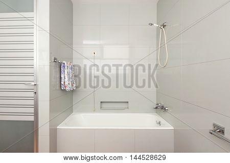 Old domestic bathroom of an apartment, bathtub
