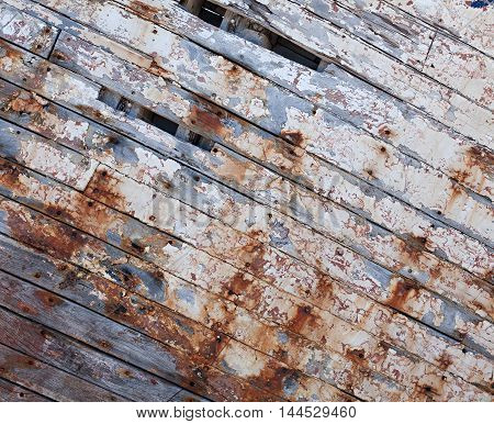 Old painted shabby wooden planks, close up