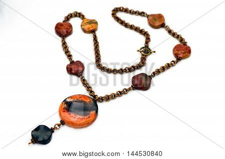 Handmade pendalt with copper chain isolated on white background