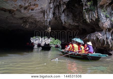 HA LONG, VIETNAM, June 24, 2016, tourist groups, boating cave tours, Ha Long Bay. World Natural Heritage, Quang Ninh province, Vietnam