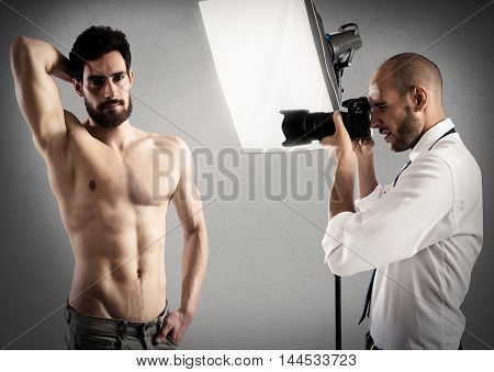 Photographer takes pictures of a man model