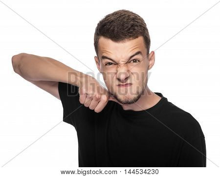 Young man gesturing a cutting motion on her throat over white background.